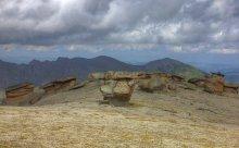 """Каменные грибы / На северном склоне Эльбруса в урочище Бырджаль, на высоте около трёх тысяч метров на небольшой ровной, чуть наклонённой площадке имеются удивительные, нигде более на Кавказе не встречающиеся, скальные образования. Природа изваяла в этом месте из слабо сцементированного кремневого туфопесчанника более двух десятков скульптур, прозванные """"ГРИБАМИ"""". До того как я там побывал, слышал, что  это место  обладает особой энергетикой (причём якобы силы берутся ниоткуда и тому подобное) и действительно место очень своеобразное, только вот 2 раза был и 2 раза из меня высасывало всё наверно, что было... хотя по ощущениям (и виду в том числе) место и правда интересное и не могу характеризовать отрицательным. Справа видна синяя фигура на грибе - это девушка на тот момент просидевшая на нём 18 часов (читала книгу когда пришли). Также истории, что над этим местом есть аномальные условия погоды (по сравнению с окружающим) имеют место быть, везде дождь там только над площадкой солнце, везде жарит, там ветрило.... вот такие загадки бывают."""