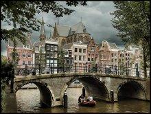 Амстердам / Каналы, мосты, велосипеды... Покосившиеся дома. Амстердам. Единственый и неповторимый.