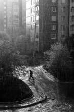 Walking under the rain / street photo from Lwow